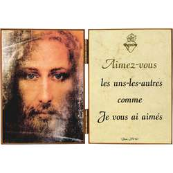 Face of Jesus and a quotation from Saint John