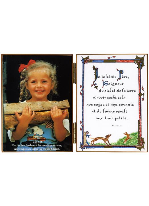 Young girl loaded with wood